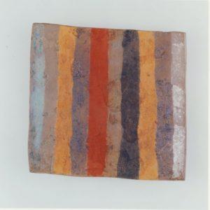 多彩帯文土製板