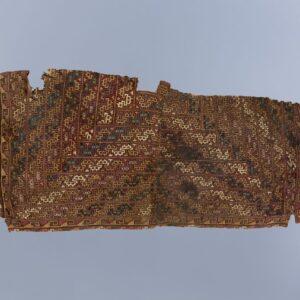 獣面文綴織縫編縁飾裂