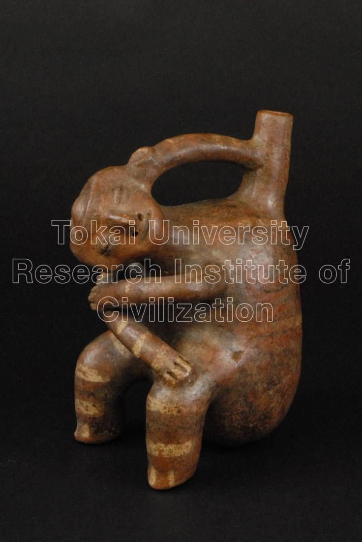 眠る男性象形把手付鳴笛壺