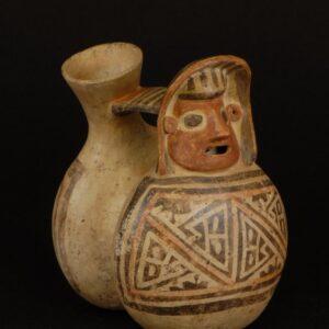 ヘビ文様彩画人頭飾鳴笛壺
