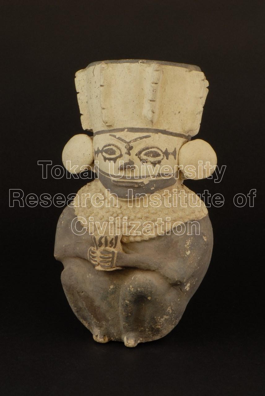 白地黒彩神官象形壺